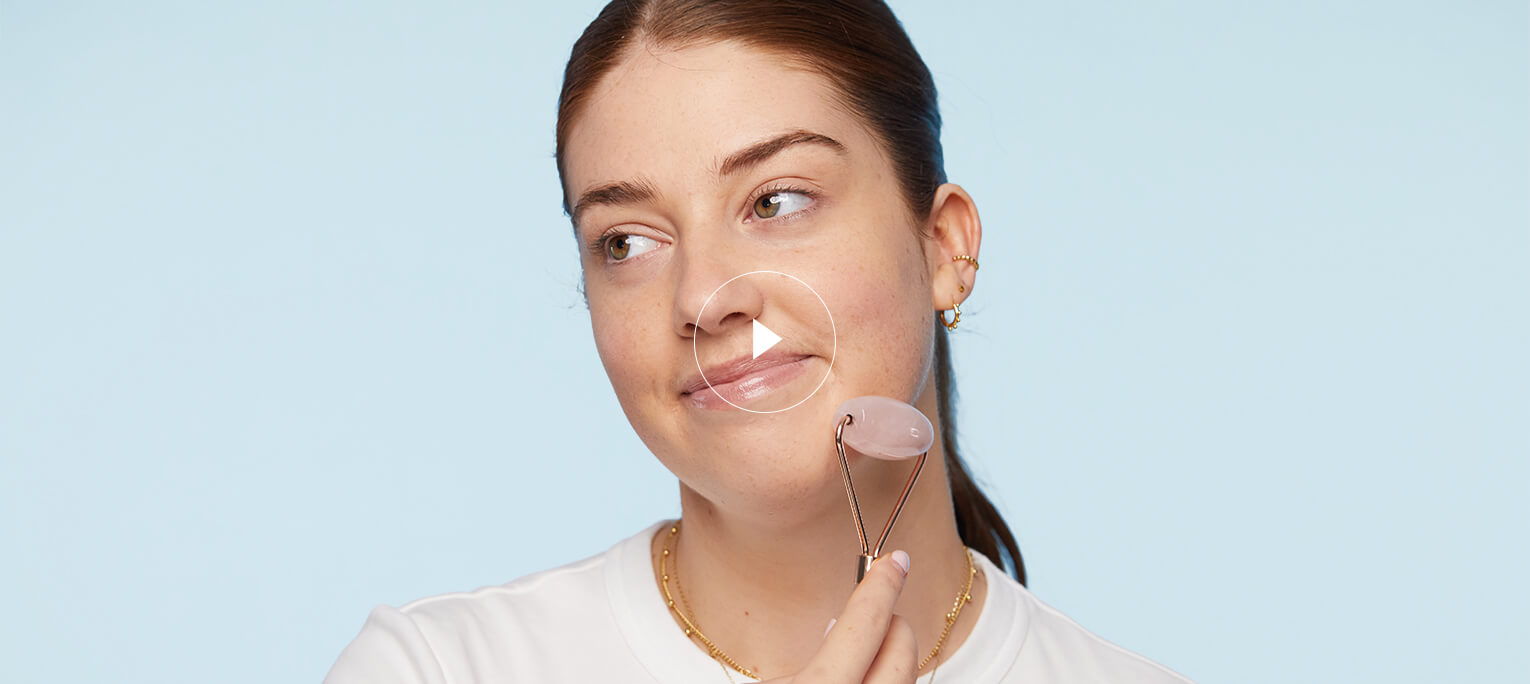 Watch: how to use a rose quartz facial roller to drain the lymphatic system